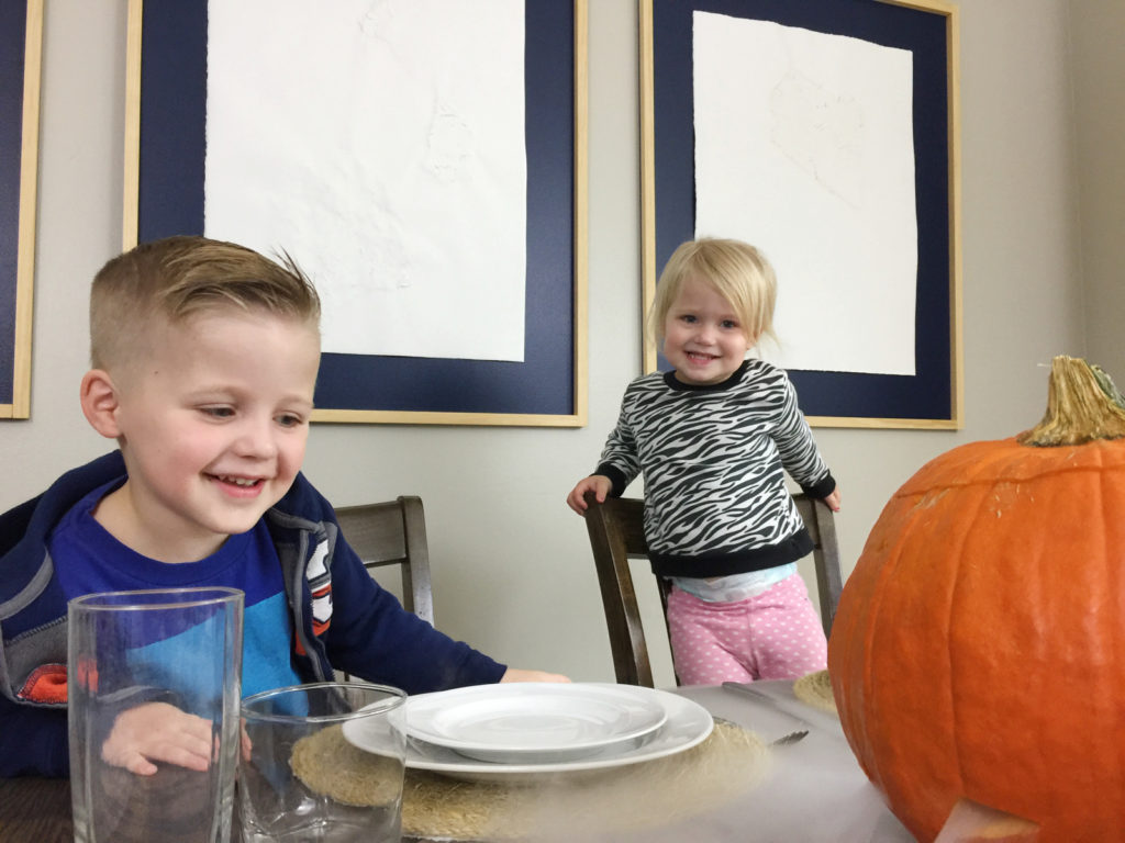 Stop here for the BEST Halloween idea you've seen all year! This is the perfect family friendly Halloween party idea: make a spooky jack-o-lantern by adding dry ice and watch your table get covered in fog! Guaranteed to be a BIG hit and your new favorite family halloween tradition!