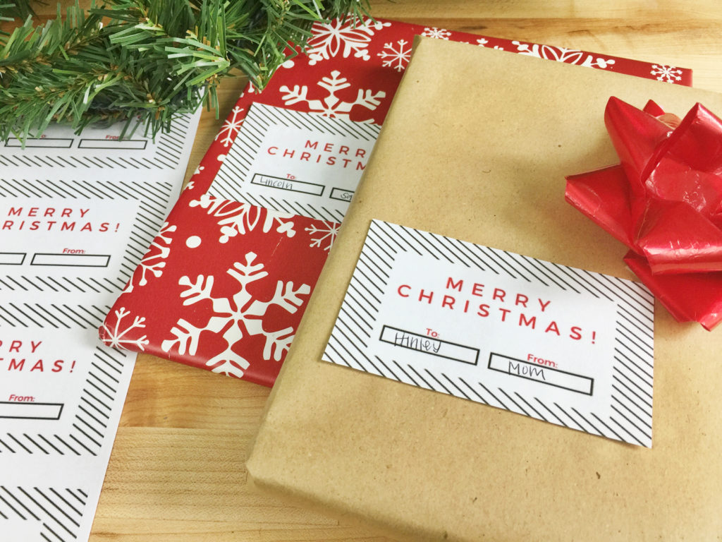 Add a unique touch to your Christmas gifts by using these stylish Christmas gift tags! Just print out your gift tag template, add names and you're done! Get your FREE holiday gift tags here! #christmas #christmasgifttags #freeprintables #christmaswrapping #holidays
